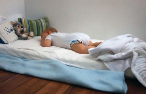 Pilar's five month old son sleeping through the night on his floor bed.
