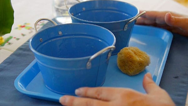Simple Montessori Activities: squeezing sponge