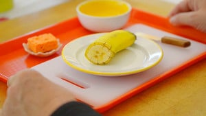 Slicing A Banana - Training for Child Skills - Voila Montessori