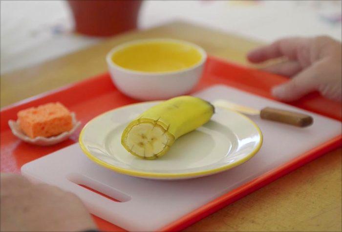 voila montessori food preparation for children - slicing a banana